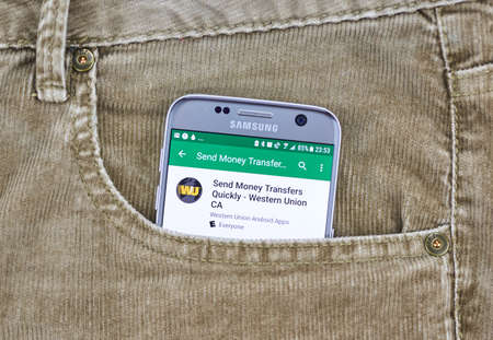 MONTREAL, CANADA - AUGUST 10, 2018: Western Union app on a cellphone screen in a jeans pocket. The Western Union Company is an American financial services and communications company.