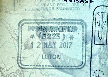 MONTREAL, CANADA - SEPTEMBER 8, 2018: Immigration Officer stamp in Canadian passport from Luton Airport, England. 報道画像