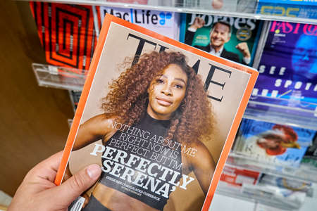 MIAMI, USA - AUGUST 23, 2018: Time magazine with Serena Williams on the cover in a hand. Time is an American weekly news magazine Editorial