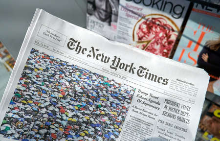 MIAMI, USA - AUGUST 22, 2018: The New York Times newspaper in a hand. The New York Times is a popular American newspaper based in New York City with worldwide influence 新闻类图片
