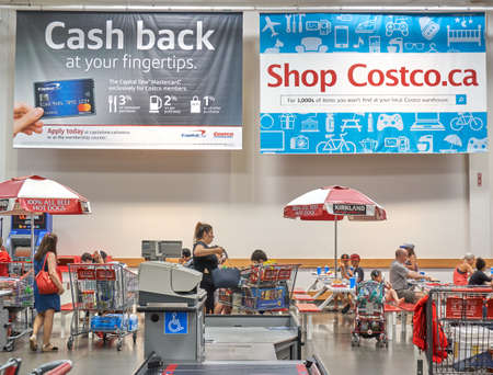 TORONTO, CANADA - AUGUST 15, 2018: Advertisement banners on Costco payment card in a Costco store. Costco, is an American corporation which operates a chain of membership-only warehouse clubs.