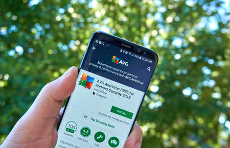 MONTREAL, CANADA - August 28, 2018: AVG Antivirus android app on Samsung s8 screen in a hand.