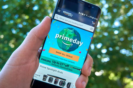 MONTREAL, CANADA - August 28, 2018: Amazon Prime Day page on Samsung s8 screen in a hand. Prime Day is a one and a half day global shopping event exclusively for Prime members