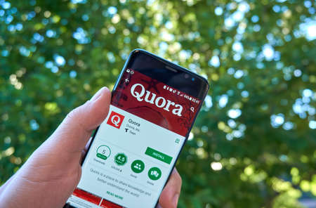 MONTREAL, CANADA - August 28, 2018: Quora android app on Samsung s8 screen in a hand.