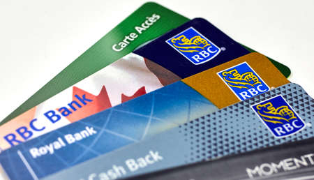MONTREAL, CANADA - SEPTEMBER 21, 2018: Royal Bank of Canada plastic payment cards. The Royal Bank of Canada is a Canadian largest bank in Canada Editorial
