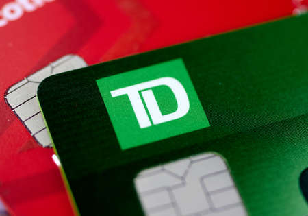 MONTREAL, CANADA - SEPTEMBER 21, 2018: TD Bank credit cards, close-up picture. The Toronto Dominion Bank is a Canadian multinational banking and financial services corporation