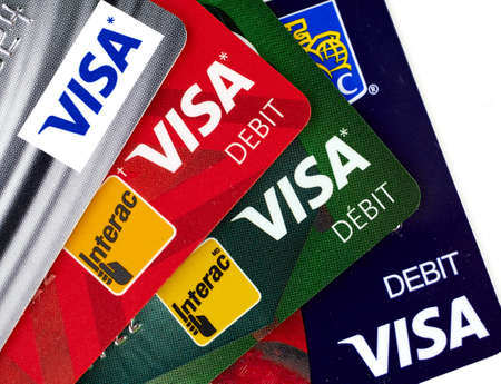 MONTREAL, CANADA - SEPTEMBER 21, 2018: Visa plastic payment cards of different canadian banks.