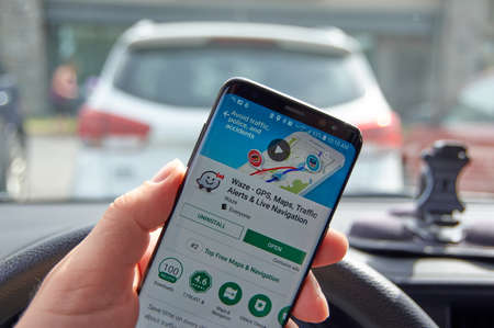 MONTREAL, CANADA - AUGUST 8, 2018: Google Waze GPS navigation app on S8 screen in a hand. Editorial