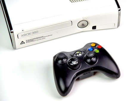 MONTREAL, CANADA - SEPTEMBER 8, 2018: Xbox 360 video gaming console with a controller on a table. The Xbox 360 is a home video game console developed by Microsoft. Stock Photo - 109528449