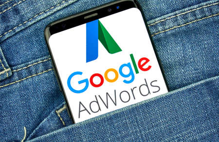 MONTREAL, CANADA - SEPTEMBER 30, 2018: Google Adwords old logo and app on Android cellphone screen. Google Ads, formerly known as Adwords, is an online advertising platform developed by Google Редакционное