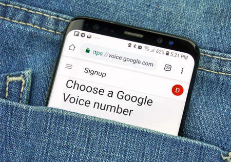 MONTREAL, CANADA - OCTOBER 4, 2018: Google Voice app on s8 screen. Google Voice is a Voice over IP service. Google is an American technology company which provides a variety of internet services.