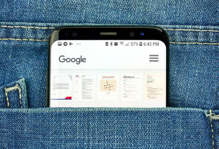 MONTREAL, CANADA - OCTOBER 4, 2018: Google Docs app on s8 screen in a pocket of a blue jeans. Google is an American technology company which provides a variety of internet services. Editorial