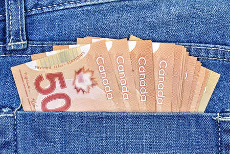 canadian money in a pocket of a blue jeans 写真素材
