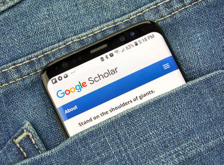 MONTREAL, CANADA - OCTOBER 4, 2018: Google Scholar on s8 screen. Google Scholar is an online service allowing users to search across variaty of academic literature, developed by Google