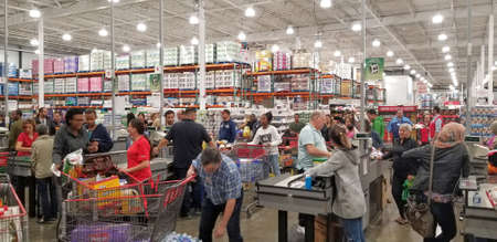 MONTREAL, CANADA - OCTOBER 5, 2018: People with carts in Costco. Costco is an American multinational corporation which operates a chain of membership only warehouses.