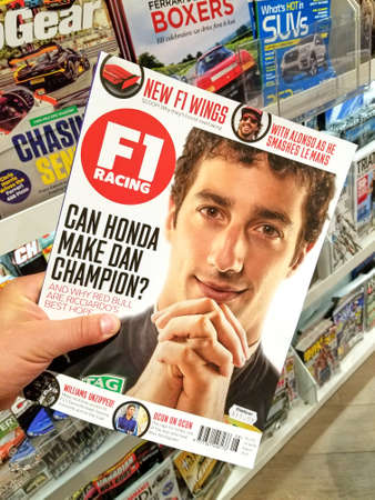 TORONTO, CANADA - DECEMBER 9, 2018: F1 Racing magazine in a hand over a stack of magazines. F1 Racing is a monthly magazine focused on Formula One racing.