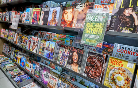 MONTREAL, CANADA - OCTOBER 9, 2018: Different popular magazines on a shelf in a store.