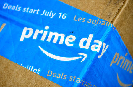 MONTREAL, CANADA - MAY 10, 2019 : Amazon Prime Day cardboard box with Prime Day logo and tape on it. Amazon Prime Day is the retailer's big members-only summer sale in month of July each year. Redactioneel