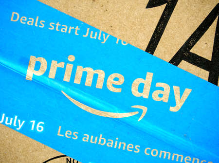 MONTREAL, CANADA - MAY 10, 2019 : Amazon Prime Day cardboard box with Prime Day logo and tape on it. Amazon Prime Day is the retailer's big members-only summer sale in month of July each year. Redakční