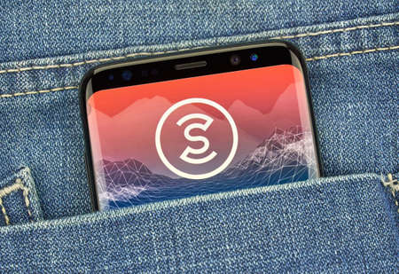 MONTREAL, CANADA - December 23, 2018: Sweatcoin android app and logo on Samsung s8 screen. Sweatcoin is a digital currency -cryptocurrency that you earn by walking or running. 新闻类图片