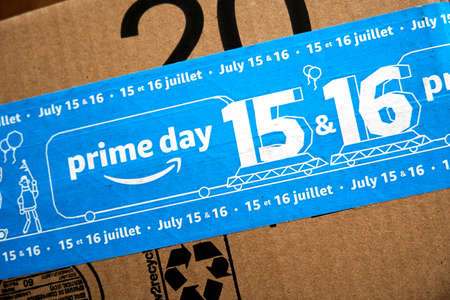 MONTREAL, CANADA - JUNE 28, 2019 : Amazon Prime Day 2019 cardboard box with Prime Day logo and tape on it. Amazon Prime Day is the retailer's big members-only summer sale in month of July each year. Redactioneel