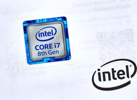 MONTREAL, CANADA - DECEMBER 8, 2018: Intel label logo of i7 8th generation CPU and printed on manual. Intel is an American multinational corporation and technology company headquartered in California Redakční