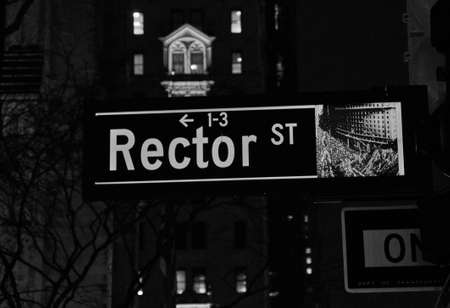 Rector street sign in New York USA, black and white photograph on a skyscraper background
