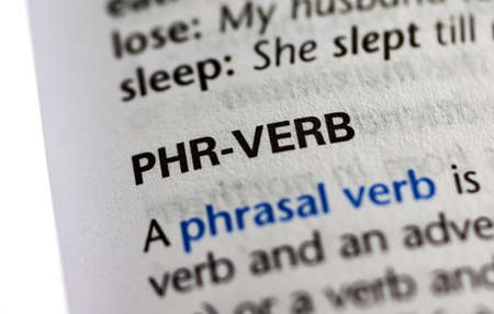 MONTREAL, CANADA - JULY 17, 2019: word phr-verb in a dictionay with meaning. Close-up and selective focus.