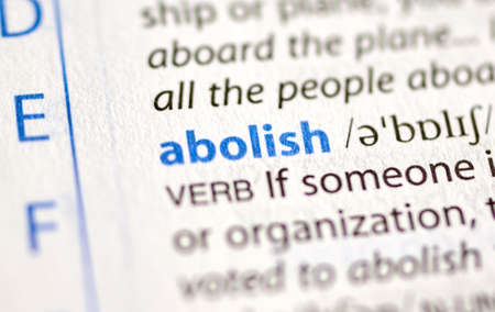 MONTREAL, CANADA - JULY 17, 2019: word abolish in a dictionay with meaning. Close-up and selective focus.