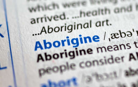 MONTREAL, CANADA - JULY 17, 2019: word aborigine in a dictionay with meaning. Close-up and selective focus.