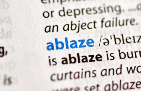 MONTREAL, CANADA - JULY 17, 2019: word ablaze in a dictionay with meaning. Close-up and selective focus. Editorial