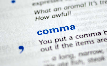 MONTREAL, CANADA - JULY 17, 2019: word and symbol comma in a dictionay with meaning. Close-up and selective focus.