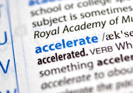 MONTREAL, CANADA - JULY 17, 2019: word accelerate in a dictionay with meaning. Close-up and selective focus. Editöryel