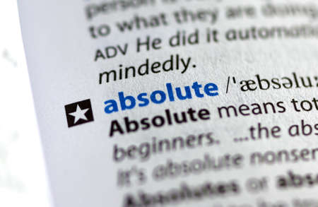 MONTREAL, CANADA - JULY 17, 2019: word absolute in a dictionay with meaning. Close-up and selective focus.