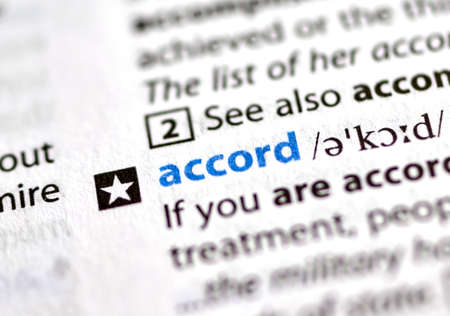 MONTREAL, CANADA - JULY 17, 2019: word accord in a dictionay with meaning. Close-up and selective focus.