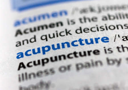 MONTREAL, CANADA - JULY 17, 2019: word acupuncture in a dictionay with meaning. Close-up and selective focus. Editöryel