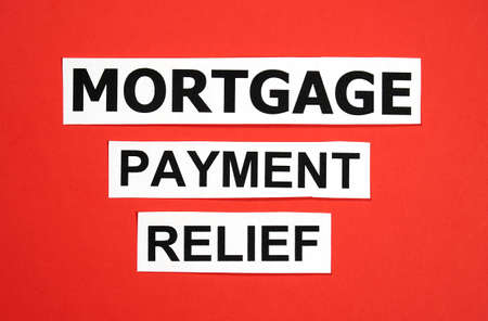 Mortgage payment relief writing on blue background. Many banks worldwide announced mortgage and payments relief because of coronavirus covid 19 for people who cannot make their payments in time.