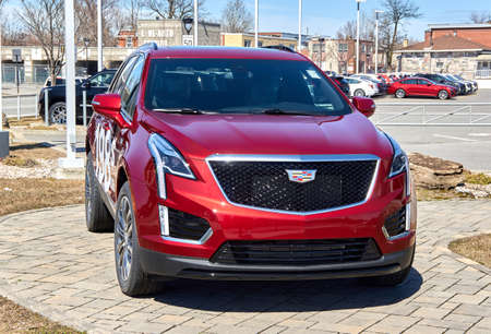 Montreal, Canada - April 4, 2020: Cadillac XT5 400 red car at dealership. Cadillac is a division of American automobile manufacturer General Motors GM that designs and builds luxury vehicles. Editorial