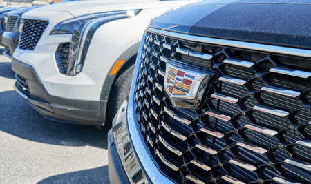 Montreal, Canada - April 4, 2020: Cadillac XT5 black car at dealership. Cadillac is a division of American automobile manufacturer General Motors GM that designs and builds luxury vehicles.