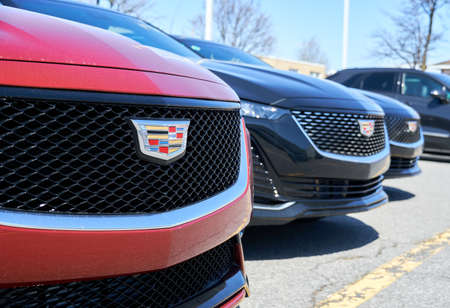 Montreal, Canada - April 4, 2020: Cadillac CT5 cars at dealership. Cadillac is a division of American automobile manufacturer General Motors GM that designs and builds luxury vehicles.