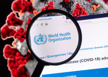 Montreal, Canada - March 11, 2020: World Health Organisation logo over Coronavirus picture. Coronavirus disease 2019 COVID-19 is an infectious disease caused by syndrome coronavirus.