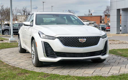 Montreal, Canada - May 2, 2020: New Cadillac 2020 CT5 350T white car. Cadillac is a division of the American automobile manufacturer General Motors GM that designs and builds luxury vehicles Editorial