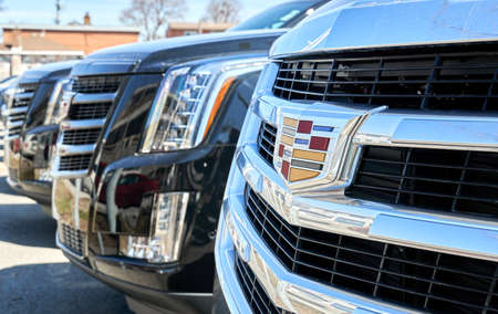Montreal, Canada - April 4, 2020: Cadillac Escalade black car at dealership. Cadillac is a division of American automobile manufacturer General Motors GM that designs and builds luxury vehicles.