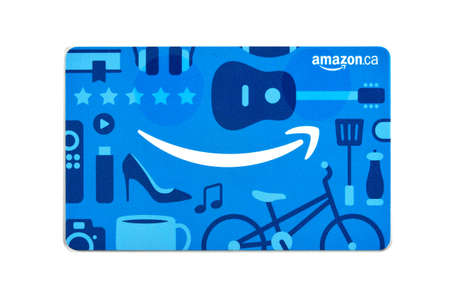 Montreal, Canada - April 6, 2020: Amazon gift cards. Amazon is a titan of e-commerce, logistics, payments, hardware, data storage, cloud computing, and media. It is founded and run by Jeff Bezos