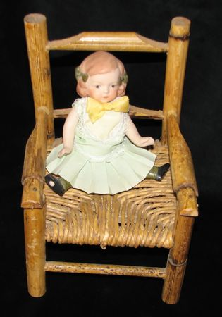Doll In Chair