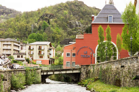 commune: View of Ville d Ax-les-Thermes, the french commune situated near Andorra, in the middle of the Pyrinees. Its a picture of the city thermal spa called Le theich Editorial