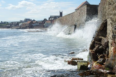 lothian: sea and waves crashing against sea wall