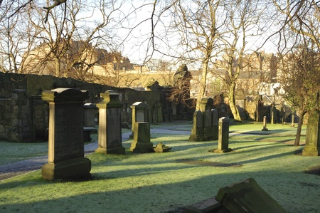 churchyard: view to Edinburgh Castle from Blackfriars graveyard on a bright winters day Stock Photo