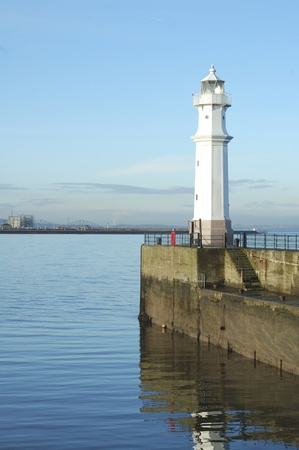 Newhaven Harbour & lighthouse looking towards Forth Bridge Edinburgh photo