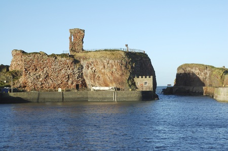 lothian: old castle and harbour entrance at Dunbar, East Lothian, Scotland in winter sunlight